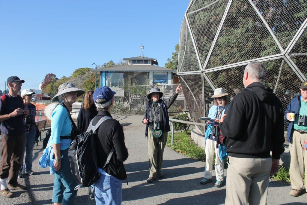 Hilary Powers outside of the Geodesic Bird Dome with a group at Lake Merritt