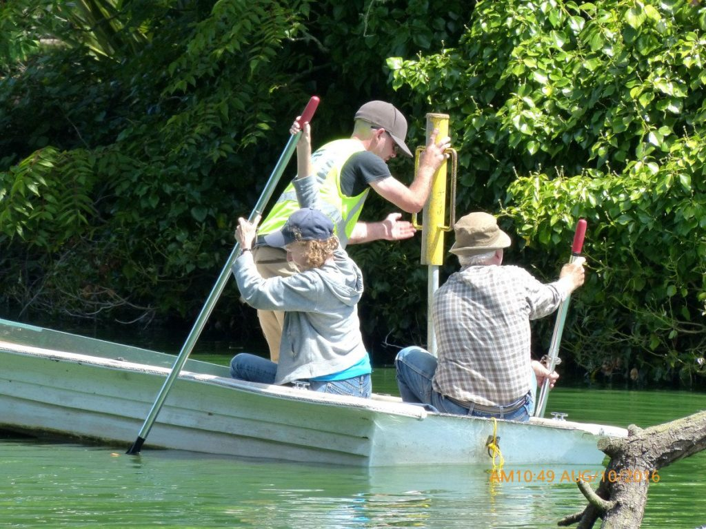 Noreen holds the boat steady while Dan installs the pole. Photo by Lee Karney