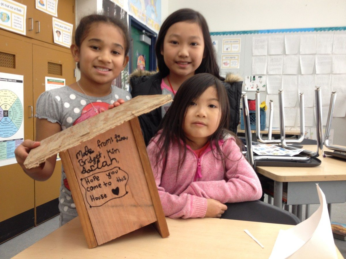 Girls from Bayview Elementary with box that the flycatchers used / Photo by Anthony DeCicco