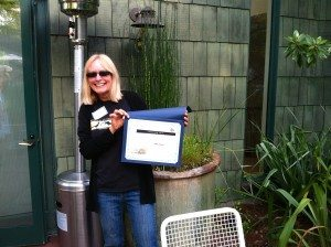 Denise Wight shows off her Paul Covel award for environmental education. Photo by Ilana DeBare.