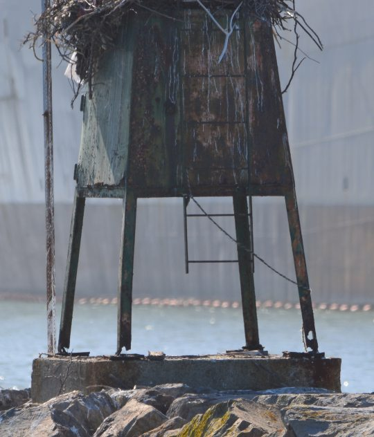 Legs of the navigation light stand are rusted through. Light was erected in 1940.