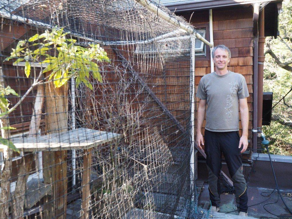 Phil Price and the original cage area of his catio complex / Photo by Ilana DeBare